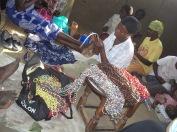 Ladies making paper beads as an IGA