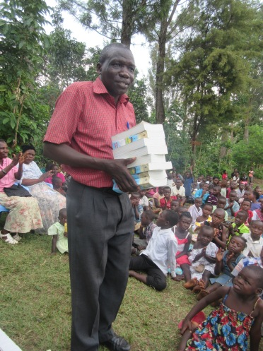 Pastor Matiya receiving donated Bibles