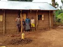 The widow and some of her children outside their new shelter