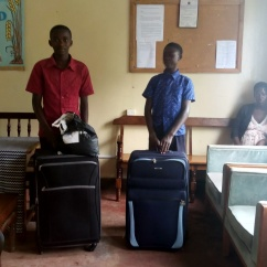Emma & Derrick collecting suitcases